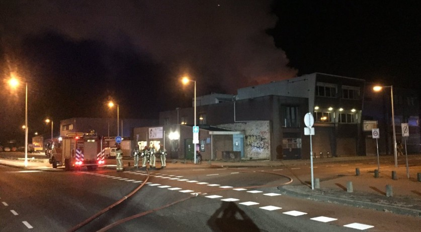 Firefighters at the scene of a fire on Slimmeweg in Amsterdam, 29 Nov 2016