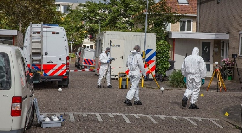 Forensic team performs a trace evidence investigation at a crime scene