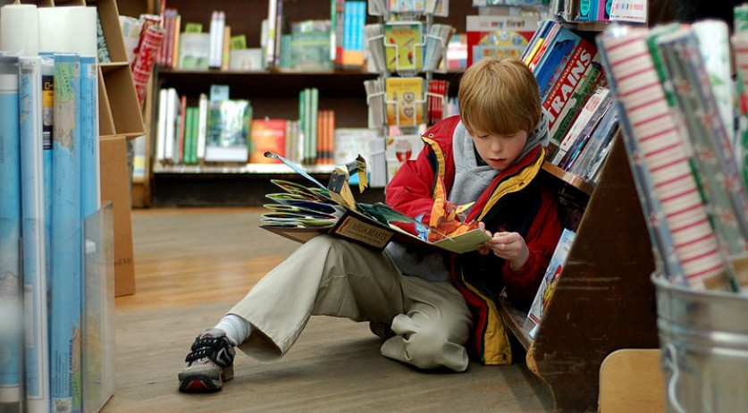 Child reading in a book store