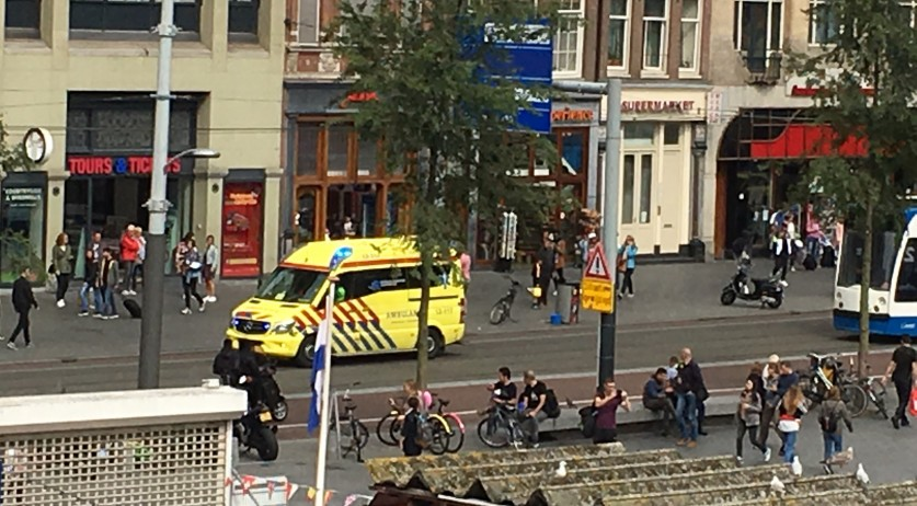 Ambulance racing down the Damrak after leaving the scene of a stabbing and police shooting at Amsterdam CS, 31 Aug 2018
