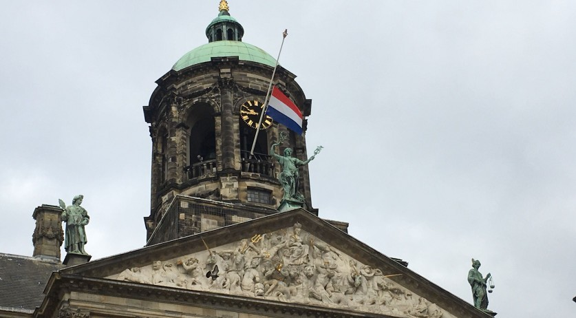 Dutch flag flying at half-staff over the Royal Palace on the Dam in Amsterdam after a mass shooting in Utrecht, 19 March 2019