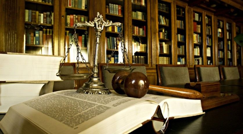 Scales of justice and gavel on law book