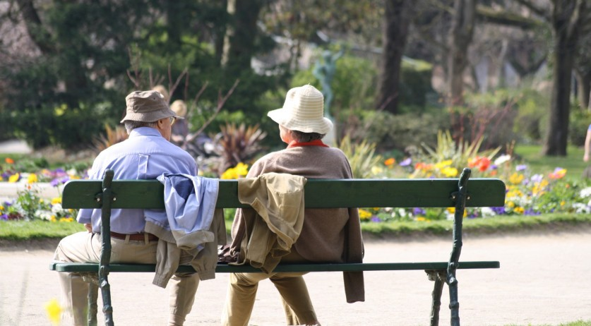 Elderly people sitting on a park bench