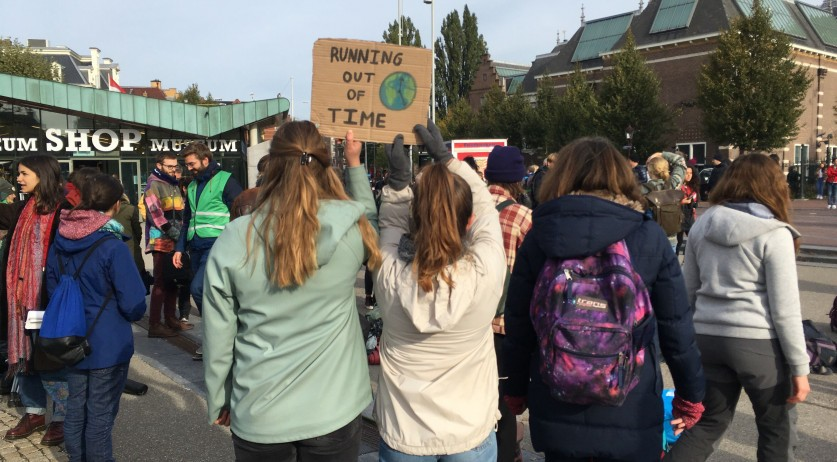 Maud and Emma holding up a sign at a climate protest by Extinction Rebellion in Amsterdam, 7 Oct 2019