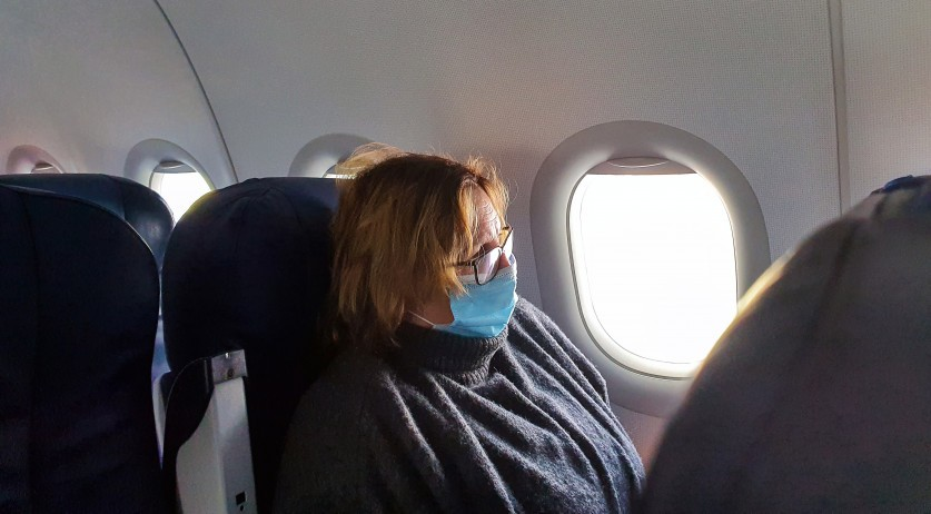 An airline passenger wearing a face mask during an October 2020 flight to the Netherlands