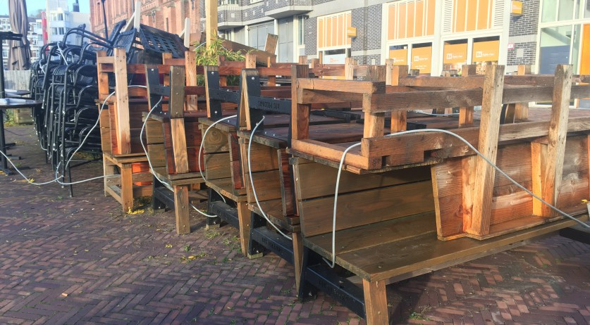 Tables, chairs and benches piled up outside of Nomads restaurant in Amsterdam Oost. 28 October 2020