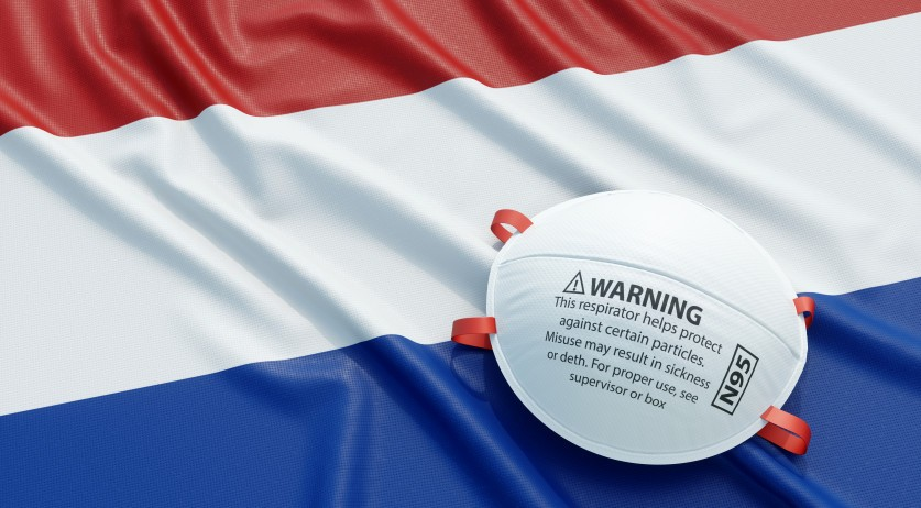 A respirator face mask and the Dutch flag