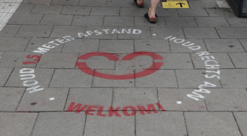 Social distancing reminder on the ground at the Hoorn train station. August 2020