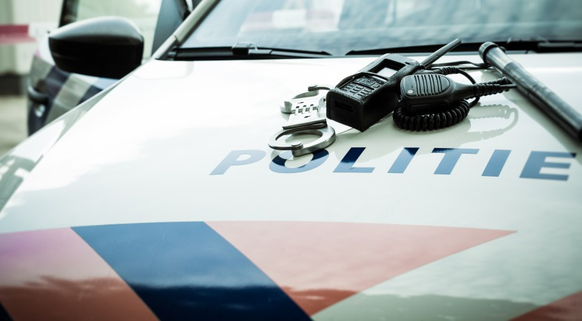 Handcuffs, radio Dutch Police Car