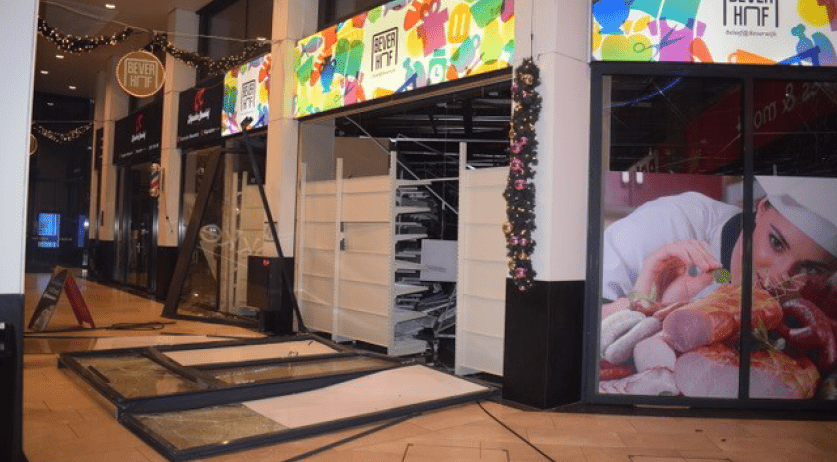 The damaged storefront of a Polish supermarket in Beverwijk after the second explosion there in a week. 11 Dec. 2020