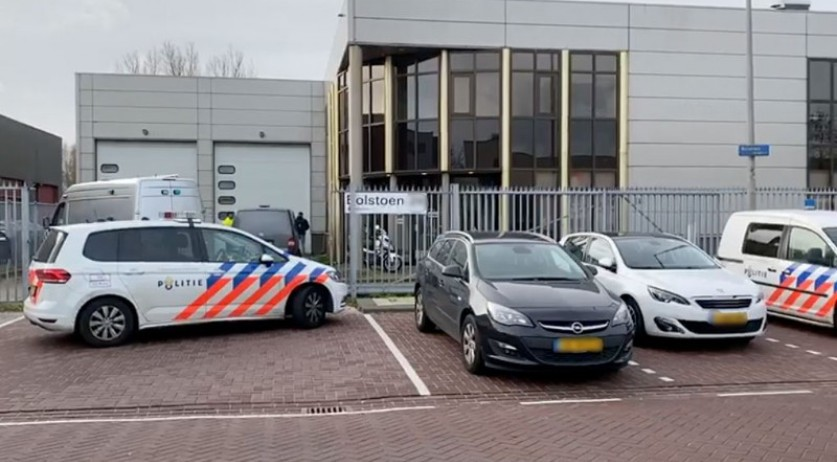 Police at an ABN Amro mail sorting center on Bolstoen in Amsterdam where a mail bomb exploded on 12 February 2020