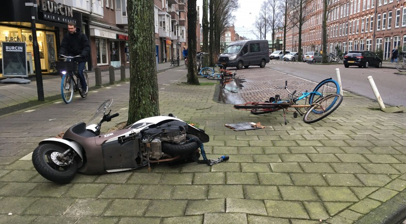 Scooters and bikes knocked over by strong winds in Amsterdam Oost, 10 February 2019
