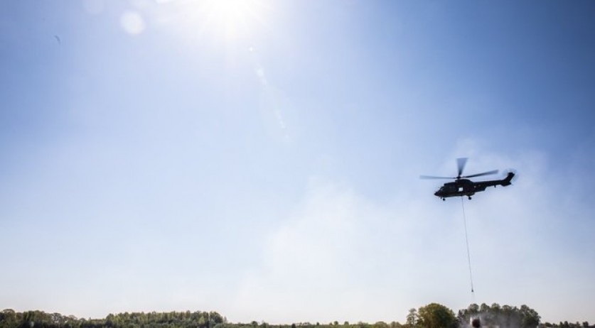 Chinook helicopters from the Ministry of Defense helping to fight a fire in National Park De Meinweg near Herkenbosch in Limburg, 23 April 2020