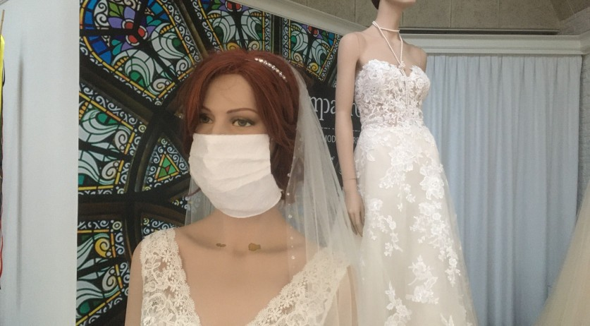 A mannequin wears a face mask in the window display of wedding shop Compagne in Hardenberg. July 3, 2020