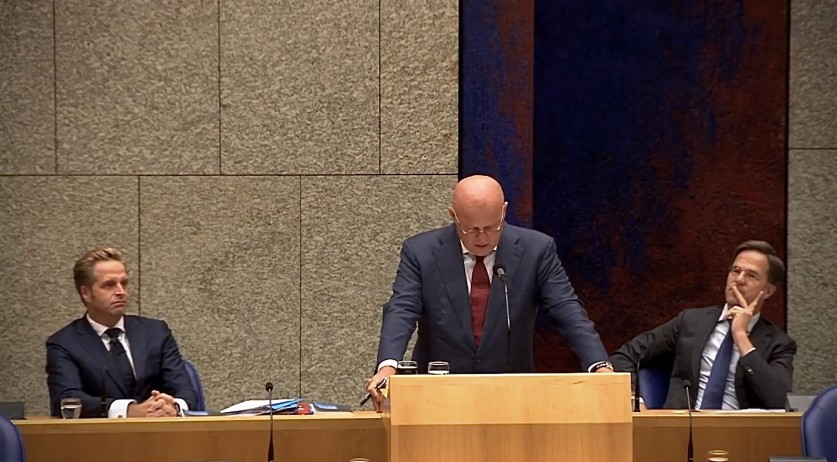Justice Minister Ferdinand Grapperhaus speaking in parliament with Health Minister Hugo de Jonge and Prime Minister Mark Rutte sitting behind him, 2 September 2020