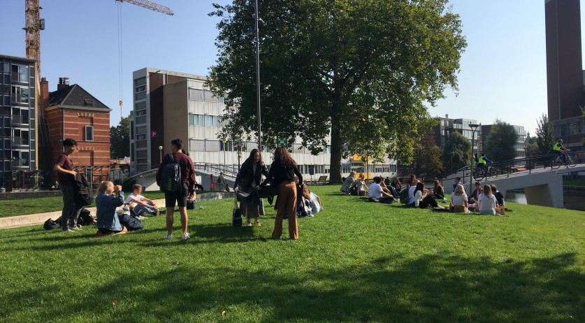 Students gather outside at the University of Amsterdam's Roeterseiland campus. Sept. 16, 2020