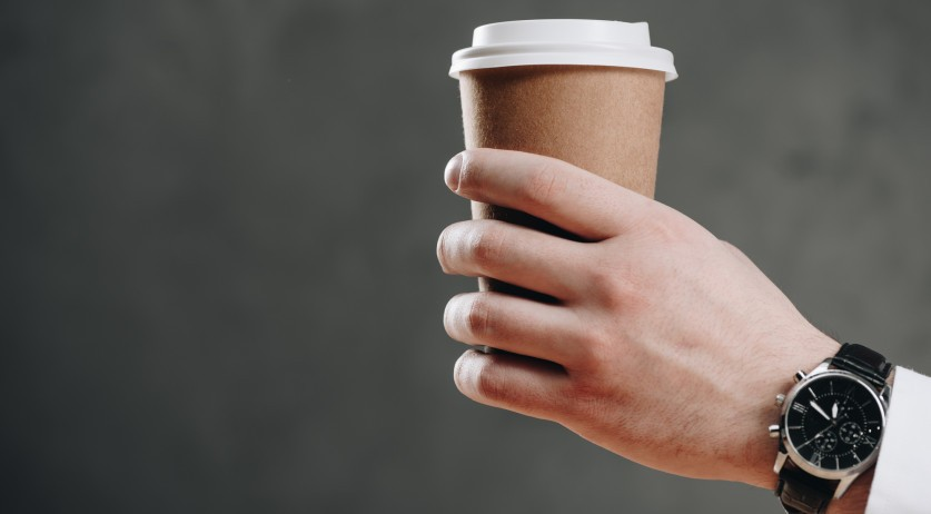 Hand handing out coffee