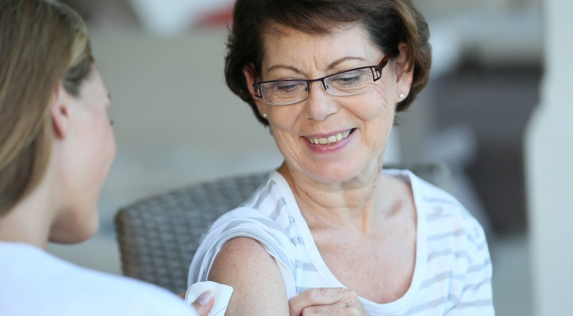 Woman receives flu vaccine
