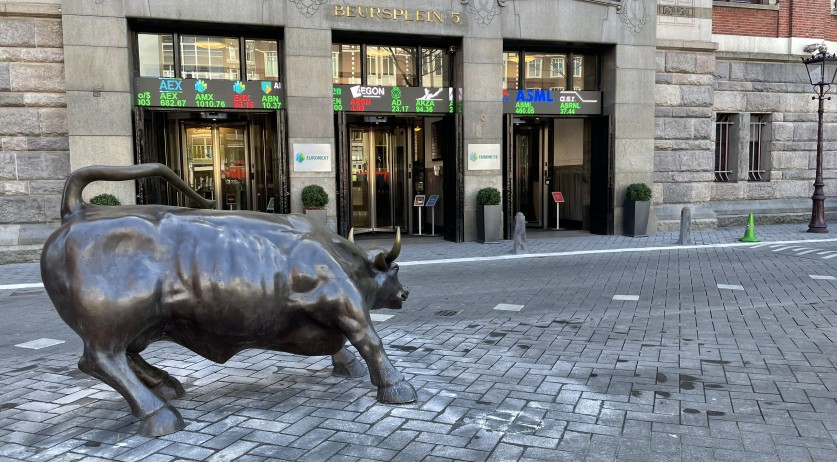 The bull statue in front of the stock exchange at Beursplein 5, home of Euronext Amsterdam. 19 March 2021