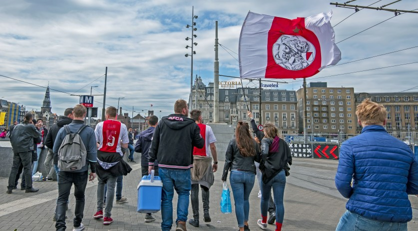 Ajax fans walking from Amsterdam Centraal to Museumplein to celebrate the team's success during the 2018/19 season