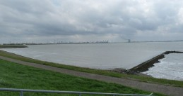 Westerschelde as seen from Bath with a Doel nuclear plant in the distance