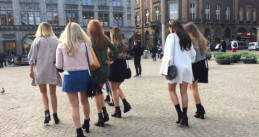 Women in Amsterdam celebrate the first official warm day of spring with short skirts, 30 Mar 2017