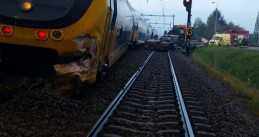 Train derails after crashing into a truck in Wouw, Noord-Brabant, 28 Apr 2017