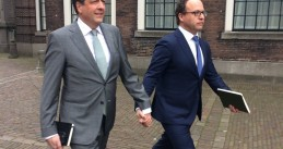 Alexander Pechtold and Wouter Koolmees walk hand in hand to support a gay couple beaten up for holding hands in Arnhem