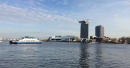 Ferry boat approaching Amsterdam Central Station, 30 March 2017