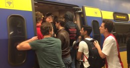 Passengers cram into a train in Amsterdam after the Europa League finals match between Ajax and Manchester, 24/25 May 2017