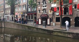 Tourists gather in Amsterdam's Red Light District, 8 Jun 2017