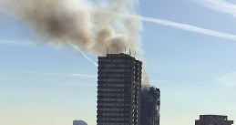 Grenfell Tower in London fire still smoldering after the overnight fire, 14 June 2017