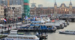 Wind whips through the flags along the Damrak in Amsterdam, 17 Jan 2018