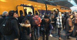 Passengers board a train to Vlissingen at Amsterdam Central Station, 19 Jan 2018