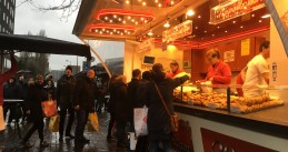 People line up at a food truck in Amsterdam Oost to buy oliebollen in time for New Year's, 31 Dec 2017