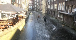Skaters on the Oudezijds Achterburgwal, a canal in Amsterdam's Red Light District, 2 Mar 2018