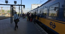 Passengers board a Brussels-bound train at Amsterdam Centraal, 9 May 2018