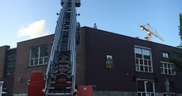 Fire department rescues a  9-year-old boy from the roof of a building on Baron G.A. Tindaplein in Amsterdam, 19 June 2018