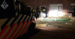 Police enter the home of a suspect of vandalism and arson in Noordwijk, 29 Oct 2018