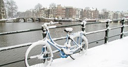 A snow covered bicycle in Amsterdam