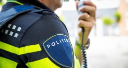 Dutch police officer talking on his radio