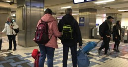 Train passengers looking for the next train to Schiphol airport at Amsterdam Centraal, 28 March 2019