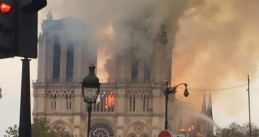 Stunned people watch a devastating fire at Notre-Dame in Paris, 15 April 2019