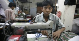 Boy working in a textile factory
