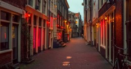 Red lights shining out of window brothels in Amsterdam's Red Light District