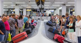 Travelers waiting or their luggage at Schiphol