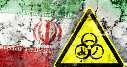 Cracked wall with the Iranian flag and a bio-hazard sign painted on it