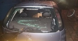 A car destroyed outside a meeting of anti-racism activists