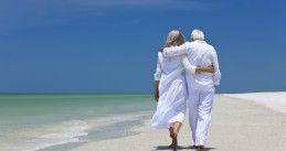 An older couple walking on the beach
