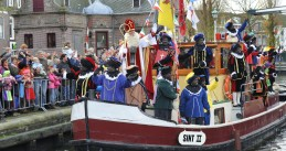 Sinterklaas and Zwarte Pieten arriving on their steamboat